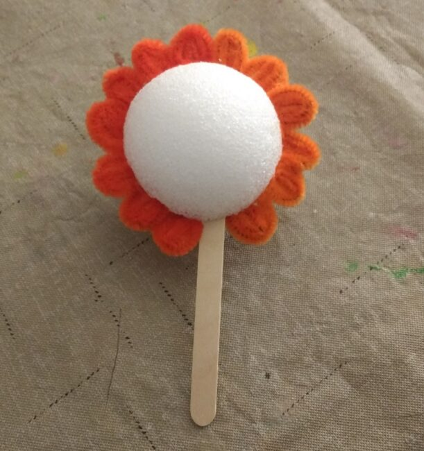 spring flower craft with rolled pipe cleaners as flower petals.