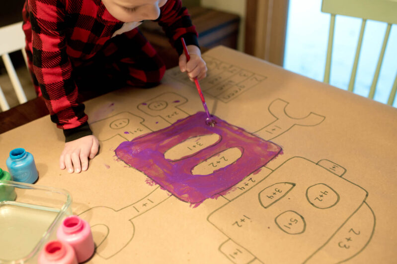This simple painting activity also works on early math skills, like number recognition, addition, and subtraction