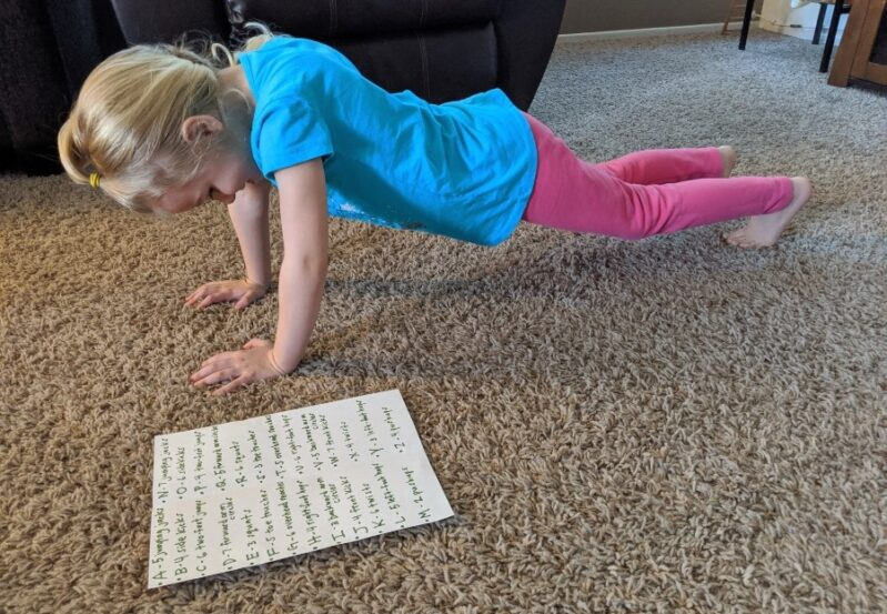 We love to spell with a fun workout-style literacy game for kids!