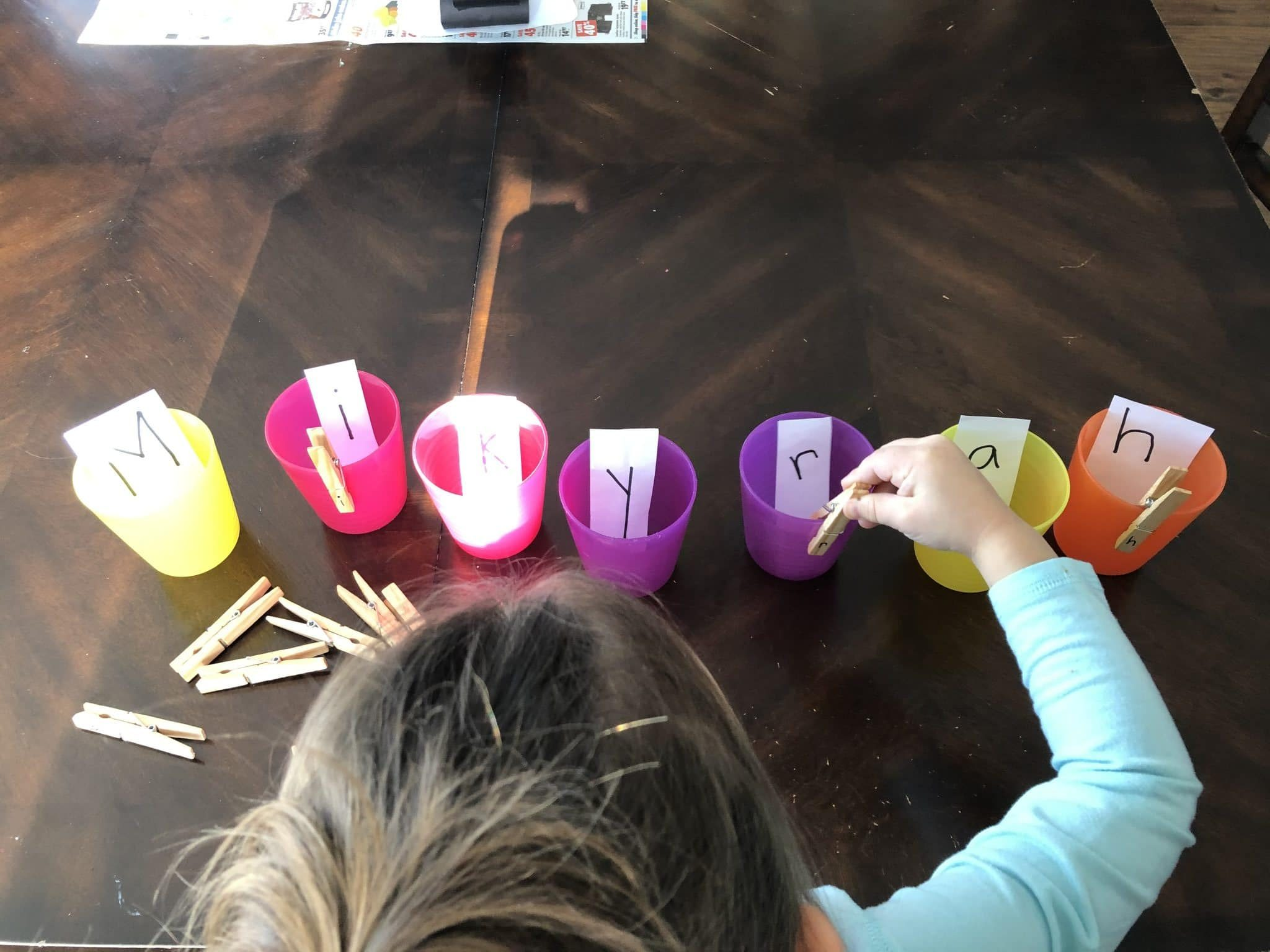 Make learning your child's name fun with this simple letter match clothespin activity. Bonus, your kids will build those fine motor skills while they do it!