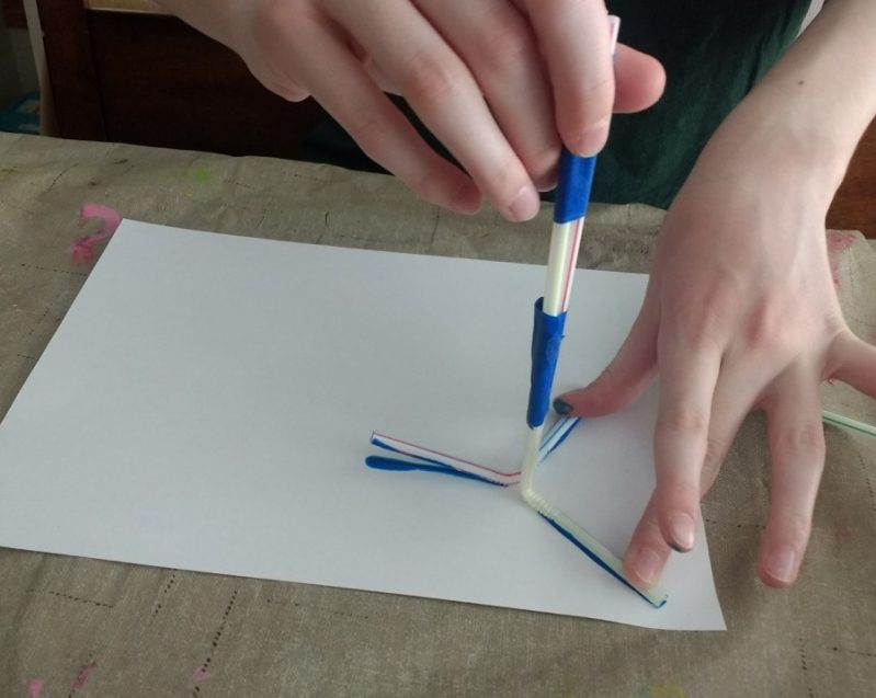 Stamping the straws onto paper