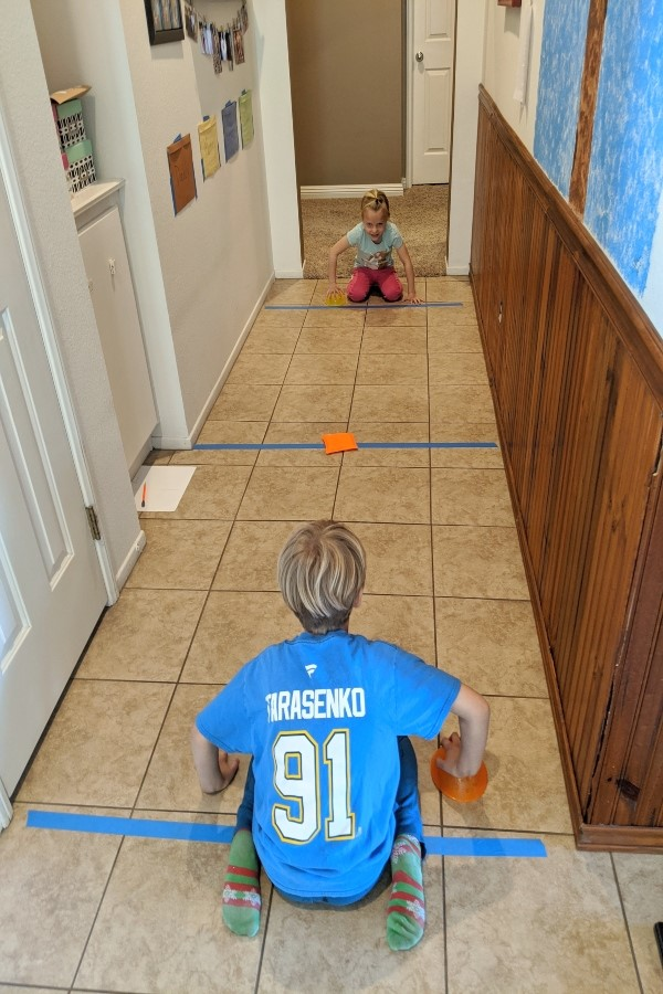 Score! Get moving and having fun with this super simple indoor hall hockey activity. It's super easy to set-up this new way to play hockey at home!