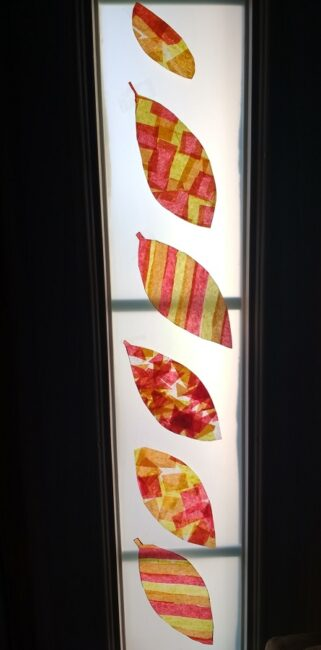 Capture the colors of fall with this super simple leaf suncatcher craft for kids. Display your beautiful tissue paper leaves all season long!