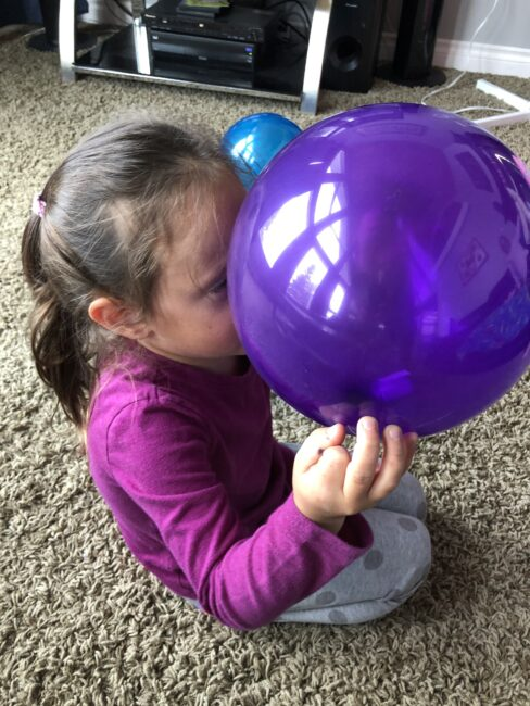 Finding the letters to spell your name in the balloon pop activity.