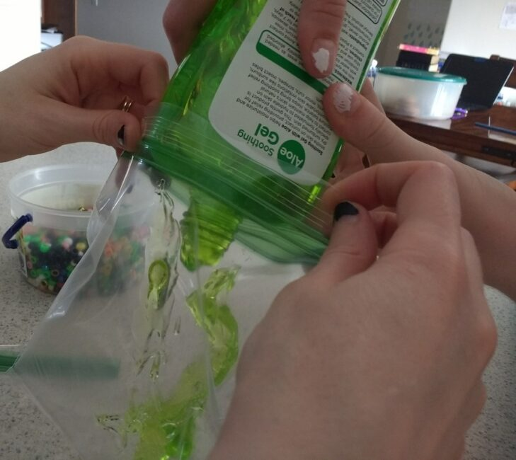 Pouring gel into resealable sandwich bags.