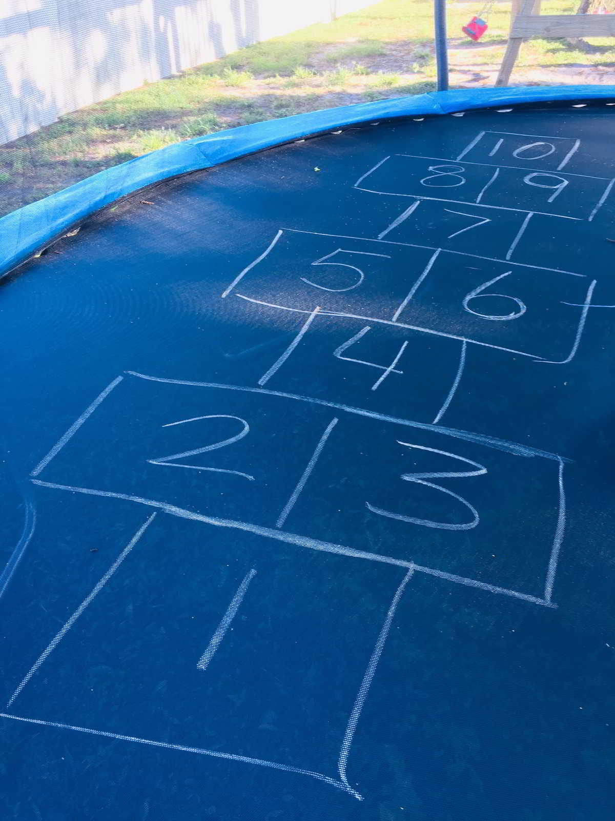 Setting up the trampoline hopscotch game for kids