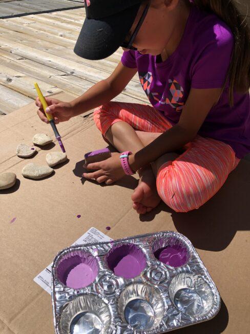 Painting rocks to create an alphabet rocks name craft keepsake for kids.