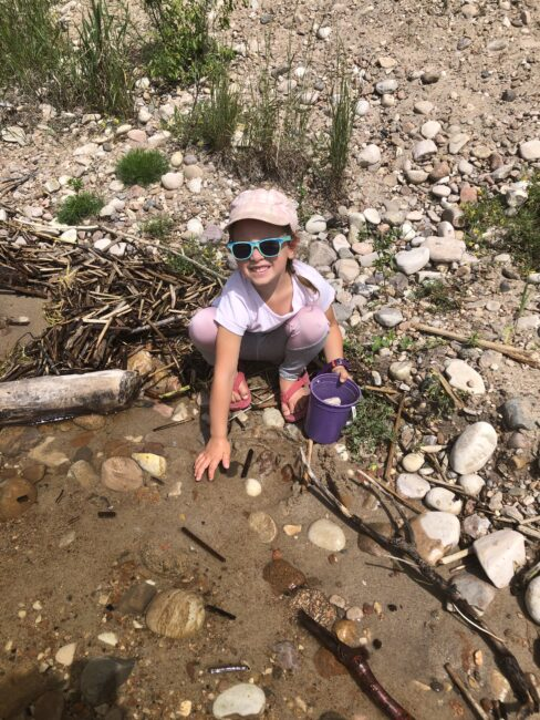 Kids out finding new rocks to add to their nature collections.