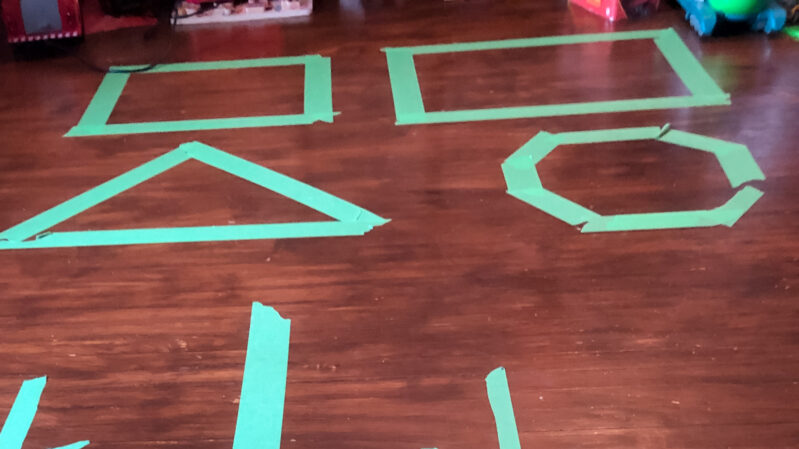 Super fun bean bag toss shapes activity to do at home with your kids!