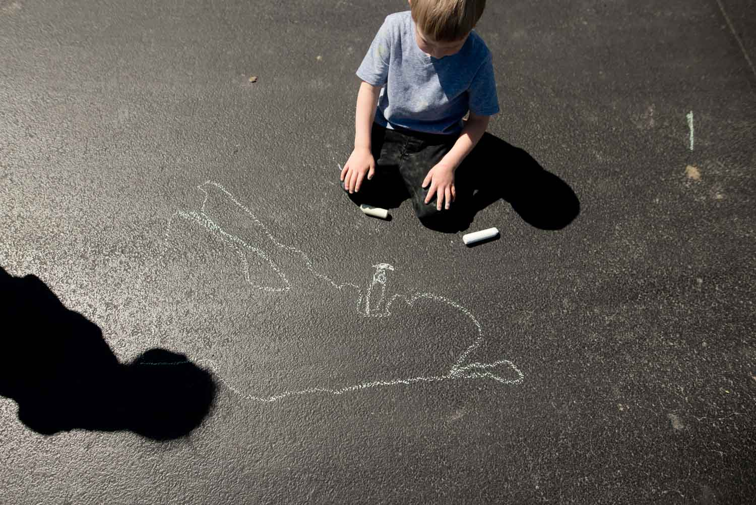 Chalk drawing activity for kids using shadow tracing as inspiration