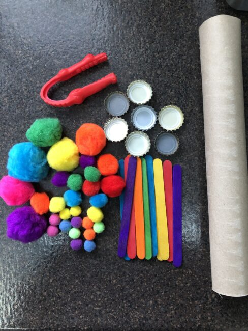 Supplies needed for pom pom balance tree activity.