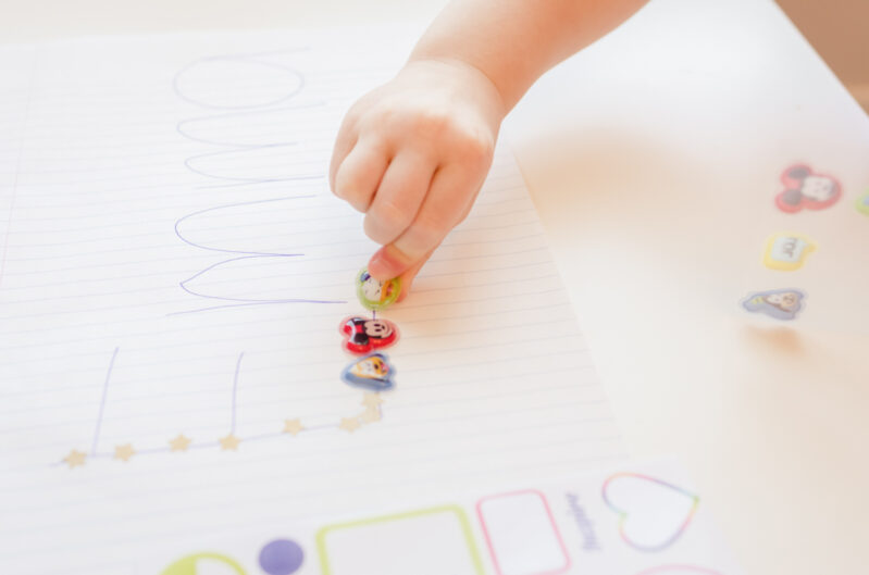Have your toddler trace their name using stickers!