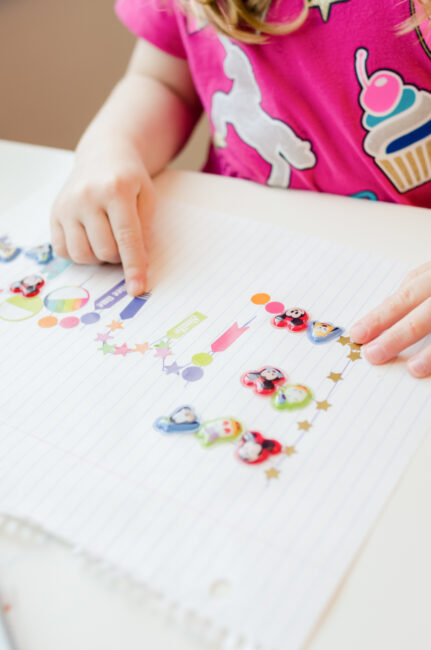 Sticker name trace activity for toddlers.