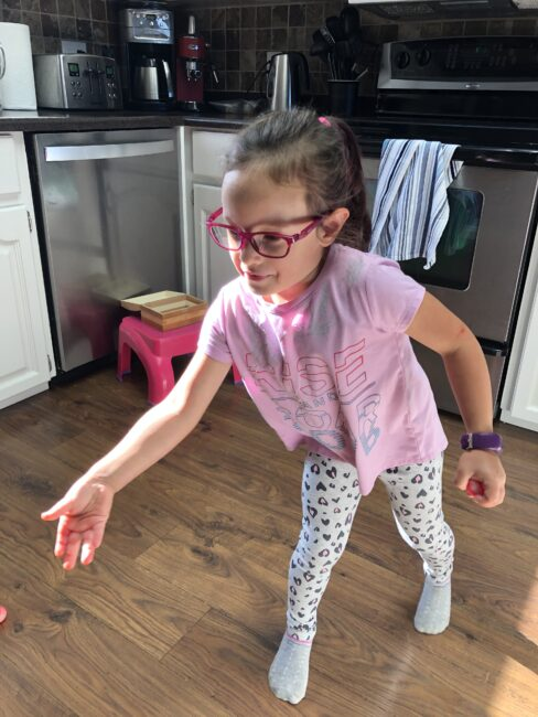 Super simple gross motor game to play at home with bouncy balls