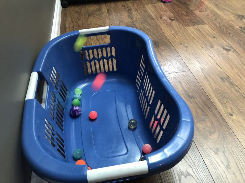 Play this super simple no-prep bouncy ball game at home today! This gross motor bouncy ball activity is sure to get laughs and giggles!