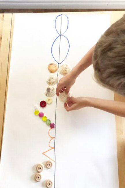 Challenge you kids with a symmetry activity using loose parts from around the house. Practice basic math skills while creating a fun little piece of art!