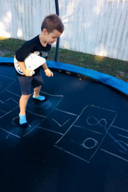 Looking for a fun gross motor game remix? This trampoline hopscotch game is easy to set up and so much fun for kids!