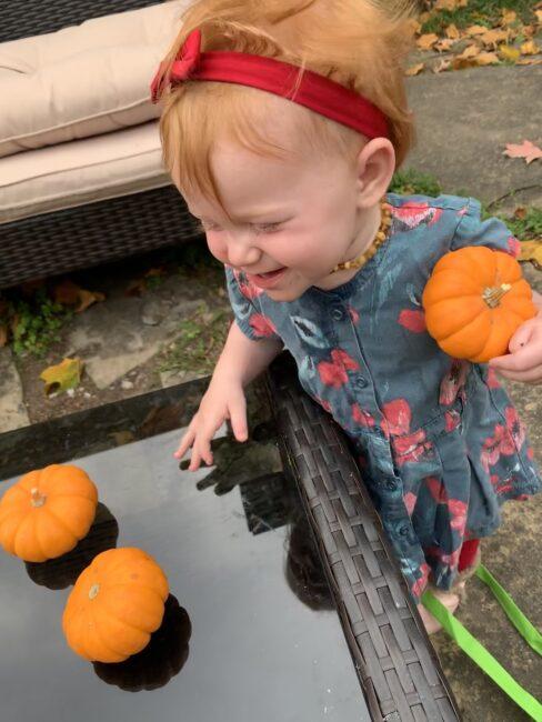 Toddler pumpkin play