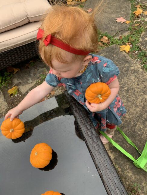 Keep baby sister busy with pumpkin play time.