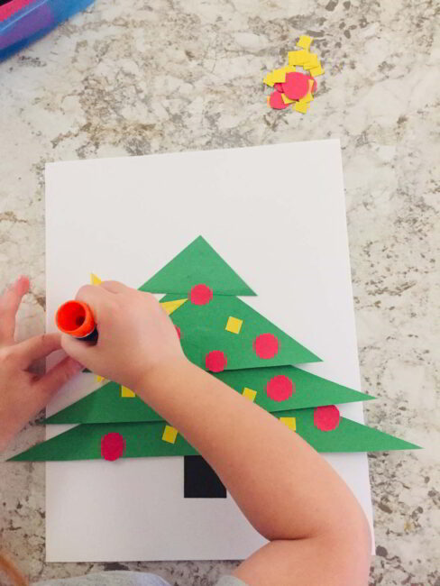 Make this simple Christmas tree shapes craft to celebrate the season!