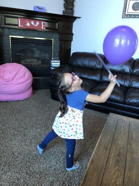Super simple balloon bump gross motor ruler game.