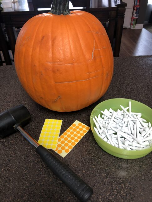 Supplies needed for Pumpkin Letters Hammering activity.