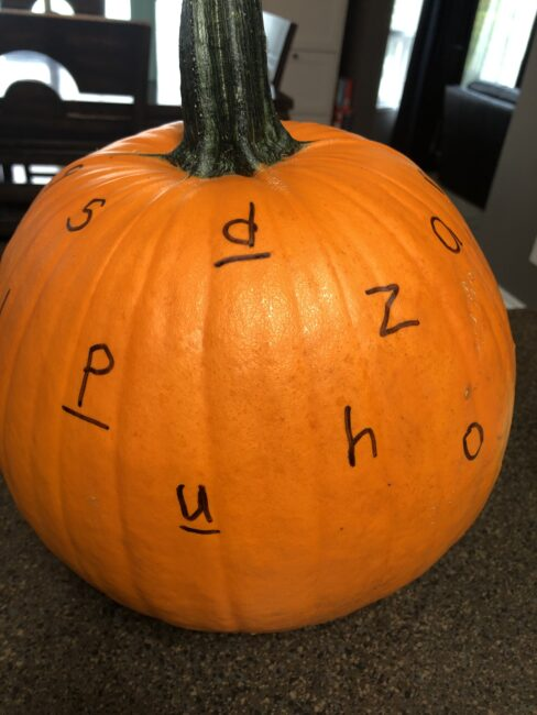 Preparing pumpkin for hammering letters activity