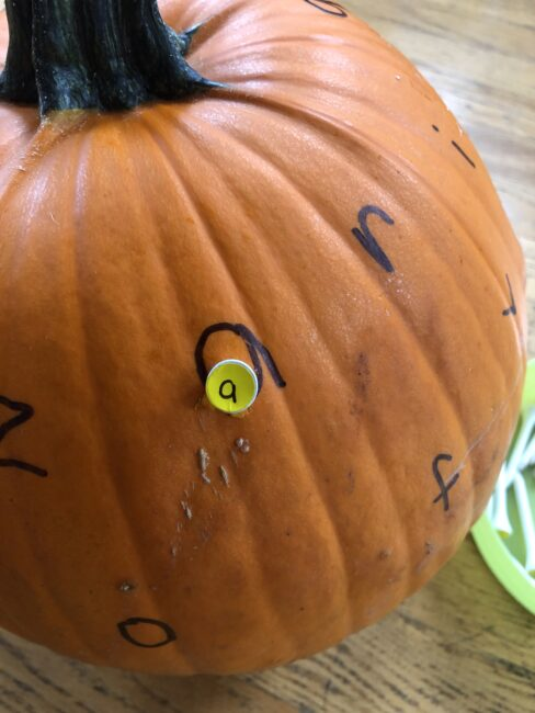 Super simple pumpkin hammering activity to teach letters through.