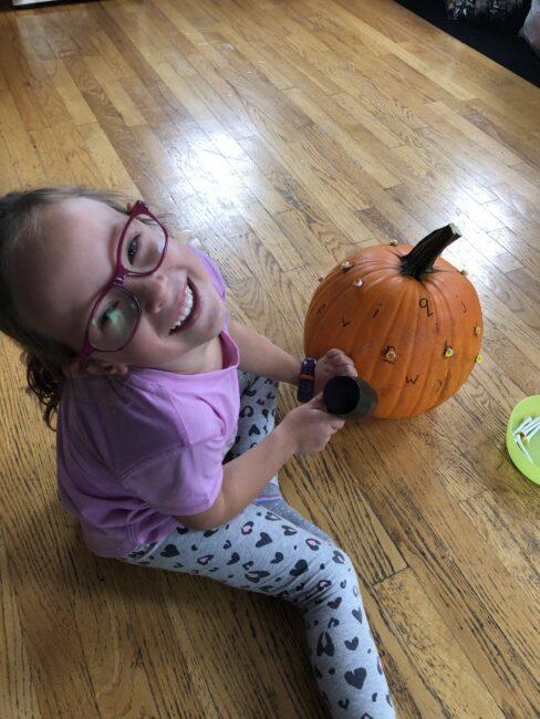 Super simple pumpkin hammering activity to teach letters through.