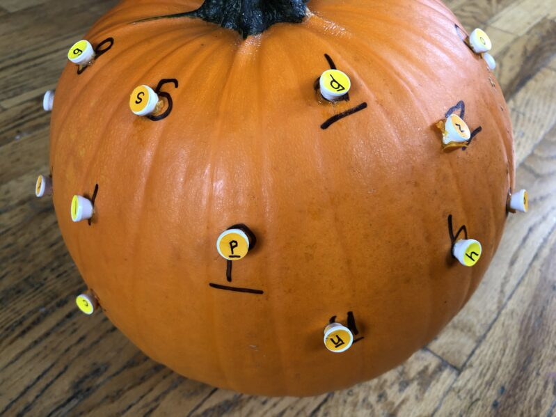 This is a super simple pumpkin hammering activity to teach letters through engaging fine motor fun for Fall.