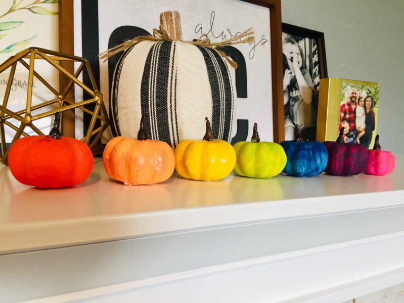 Brake out the craft paints and make the cutest rainbow painted pumpkins for kids! These colorful pumpkins are so easy and fun to make.
