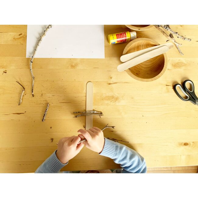 Fine motor breaking twigs for rustic stick tree ornament keepsake craft for kids.