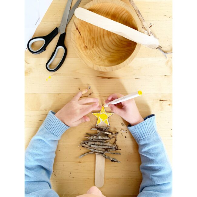 Create a rustic stick tree ornament keepsake craft for kids.