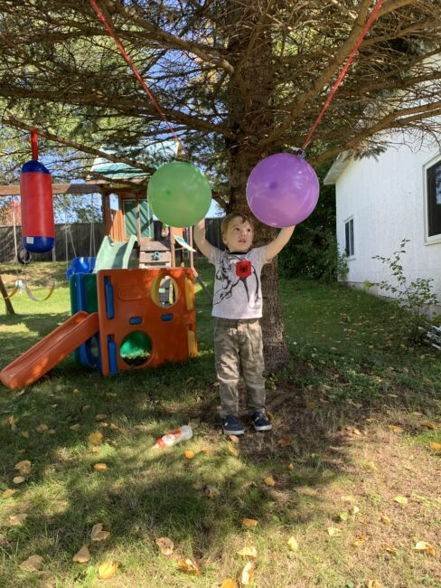 Super simple science experiment with vertical balloon straw rockets to teach kids about Newton's third law of motion or simply have some fun!