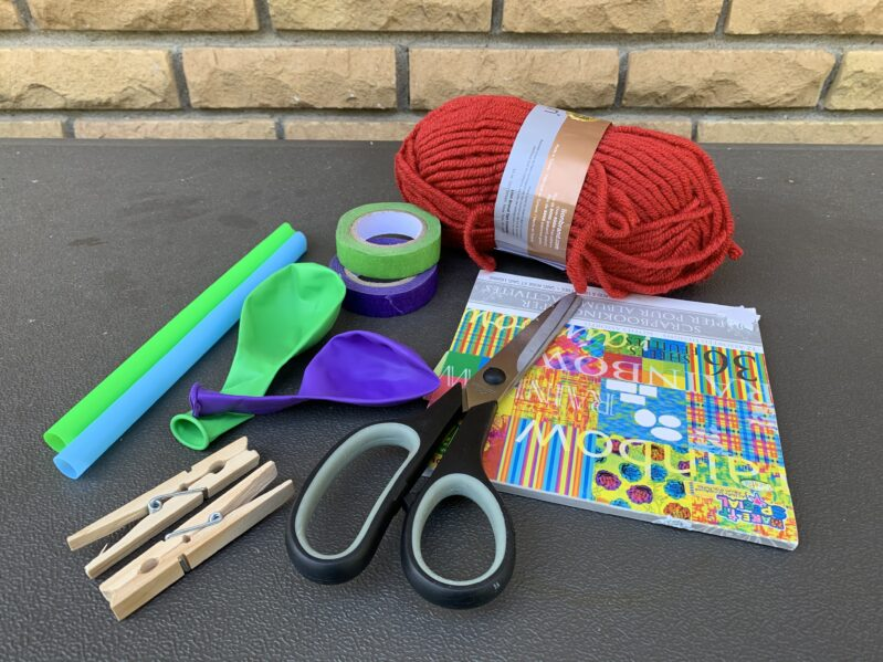 Supplies needed to make your own balloon straw rocket science experiment.