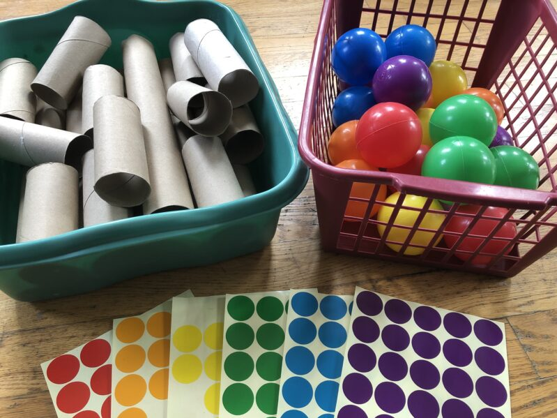 Supplies needed to make a color ball matching game at home.