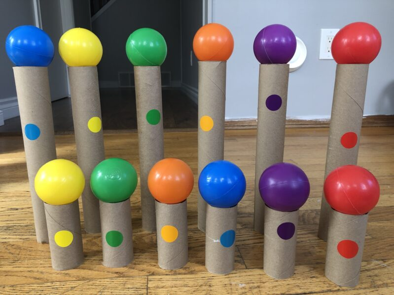 A quick and low prep fine motor activity to teach colors using ball pit balls in a balancing and color matching game for kids of all ages!