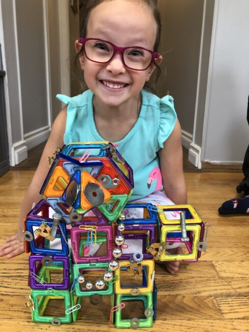 Make a robot with magnetic tiles and loose parts for creative fun with toddlers and preschoolers. Have a scavenger hunt for magnetic items too