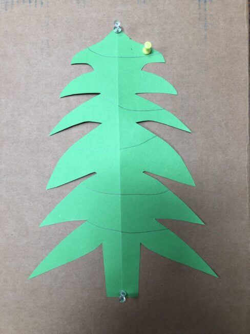 use push pins to decorate a Christmas tree for fine motor skills and color sorting or patterns