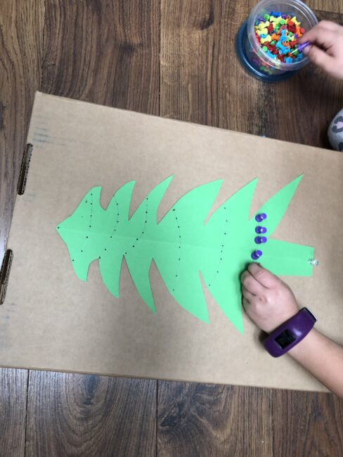 Christmas tree fine motor activity is great for sorting colors and making patterns too.