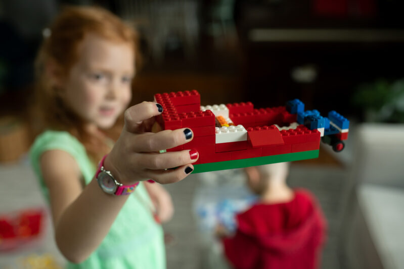 Super simple fine motor creative play Christmas LEGO Masters challenge for kids to do at home.