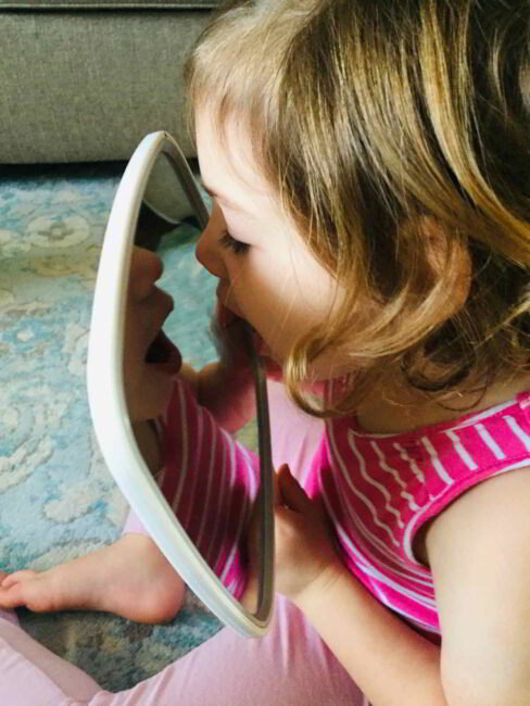 Teaching your child letters and letter sounds? Try this fun letter sounds activity to practice with a mirror!