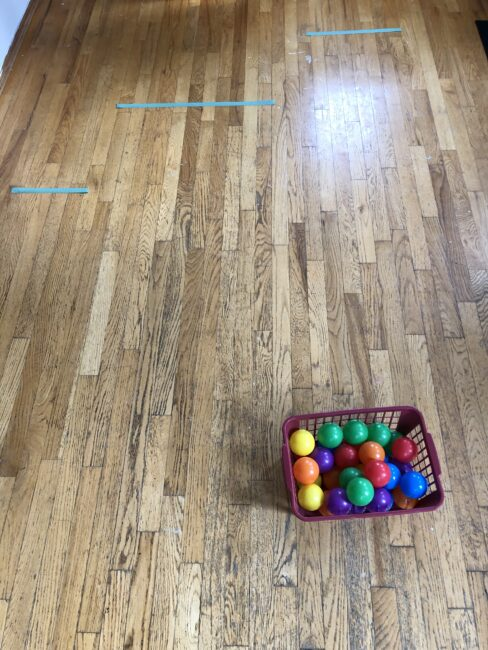 Super simple sticky line ball rolling activity for kids.