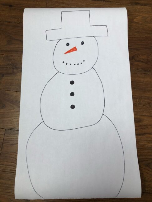 Draw a snowman on a large sheet of paper for snowman activity.