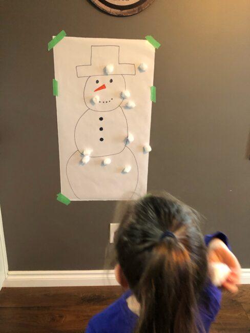 Gross motor indoor cotton ball snowman activity for toddlers and preschoolers.