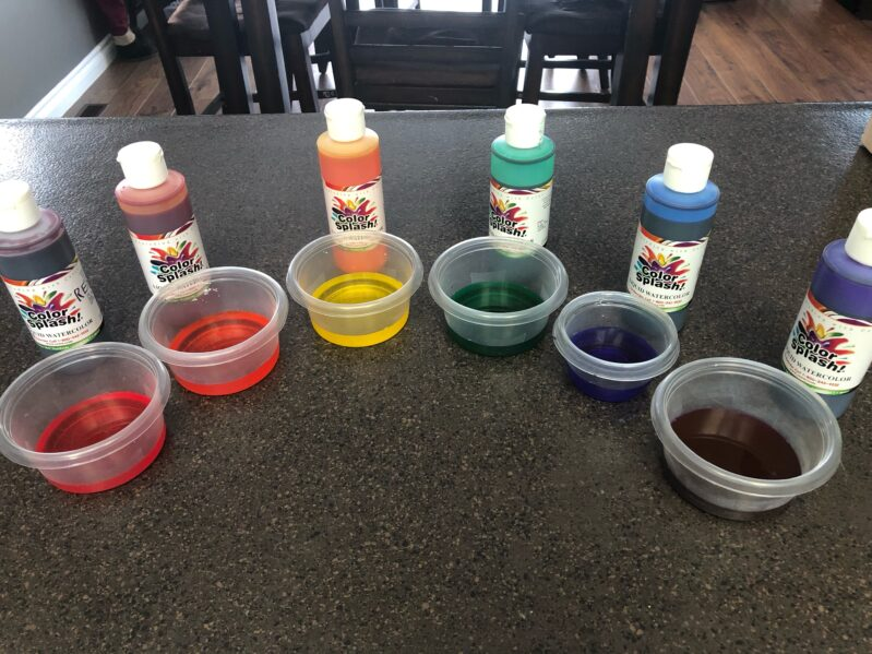 Create diluted matching colors for cotton ball rainbow art.