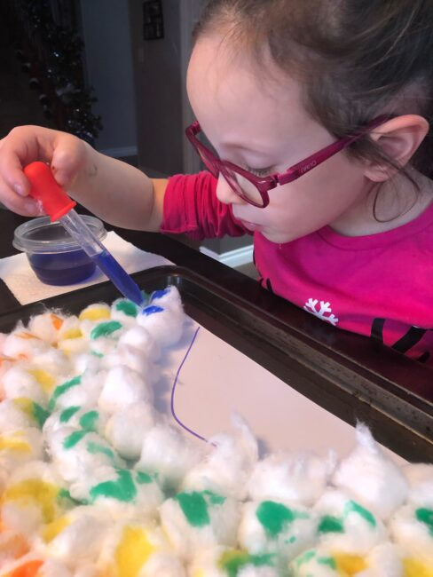 Make rainbow art with cotton balls and let your toddler or preschooler engage those fine motor skills while being colorful and creative.
