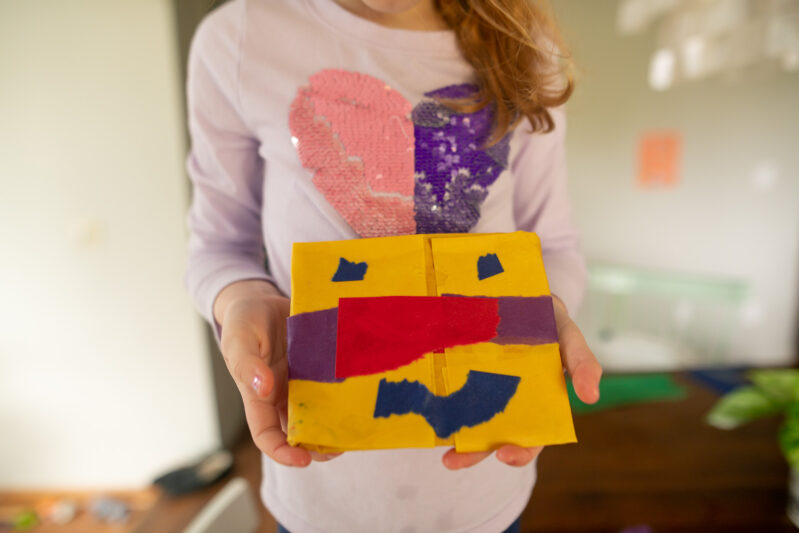 Creating with wet construction paper.
