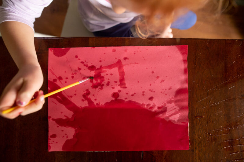 Splatter paint with water construction art activity for kids.