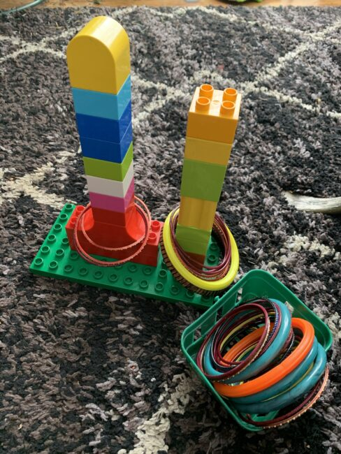 Super simple DIY ring stacking toy activities for baby or toddler using items you have at home. Easy fine motor activities for toddlers.